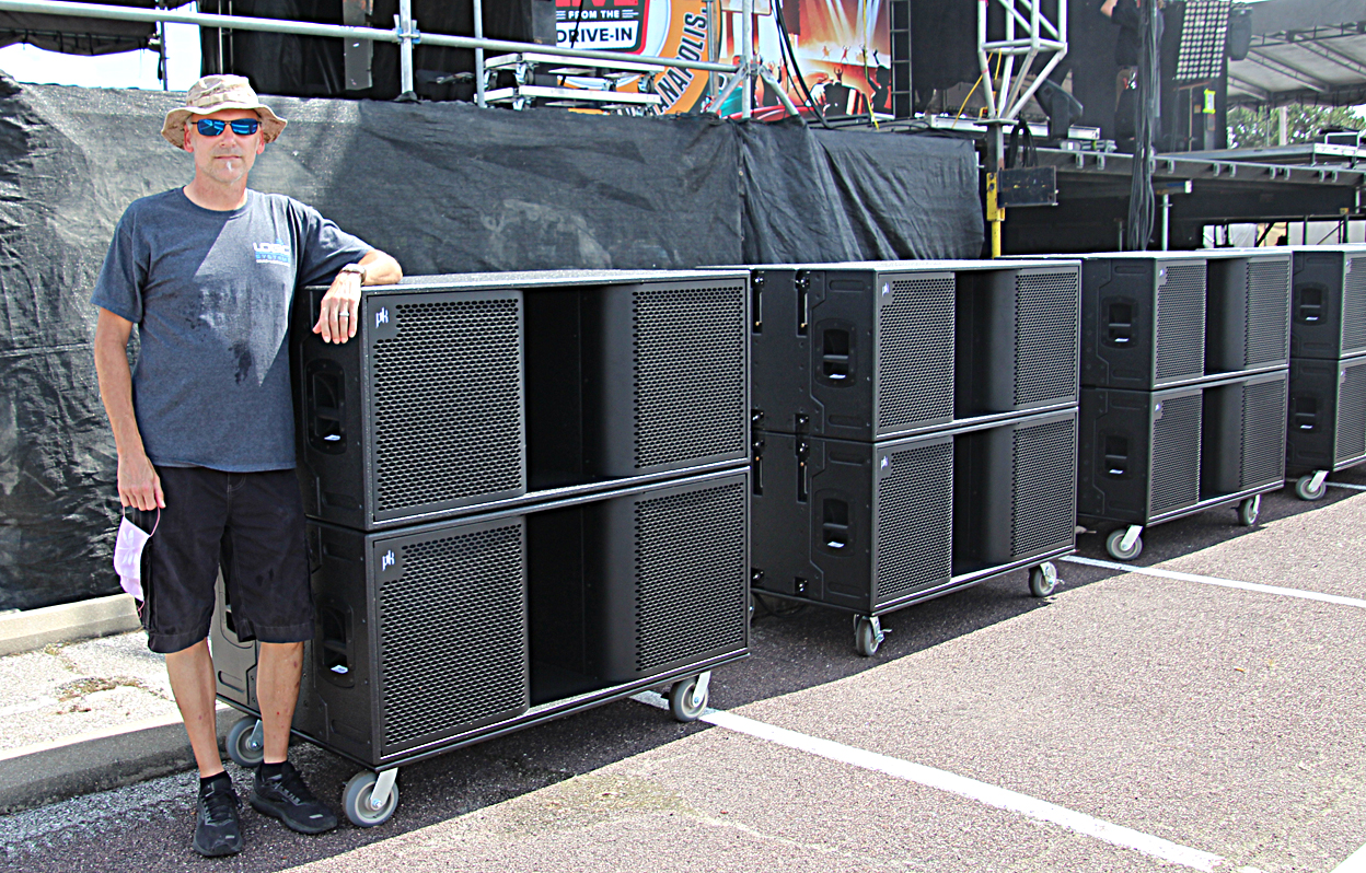 Logic Systems owner Chip Self with a few of the 30 PK Sound Gravity subs employed for the event. Photo: Kevin M. Mitchell