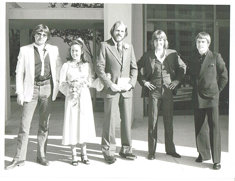 Boomer, center, with wife Susann and ELP band members.