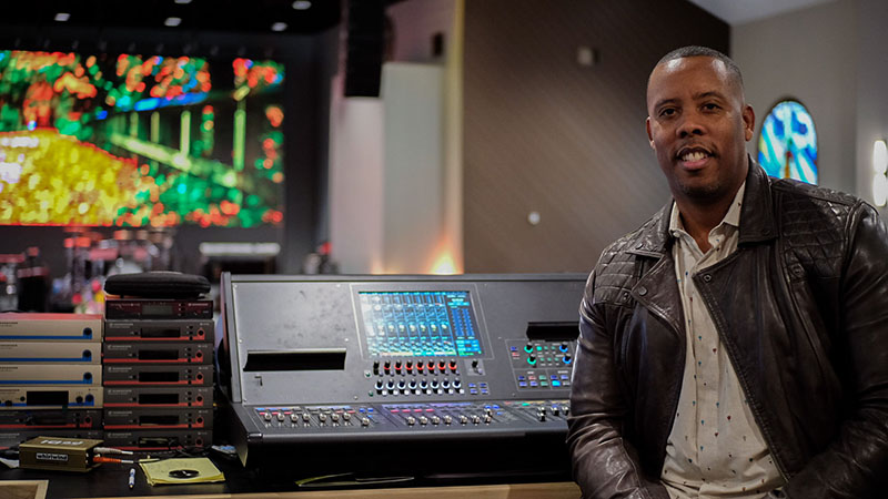 Nisan Stewart, senior pastor of Greater Emmanuel Temple Church in Lynwood, CA, pictured with the church's Roland M-5000 OHRCA Live Mixing Console.