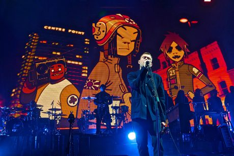 Band co-founder Damon Albarn plays along with animated characters on the big screen.