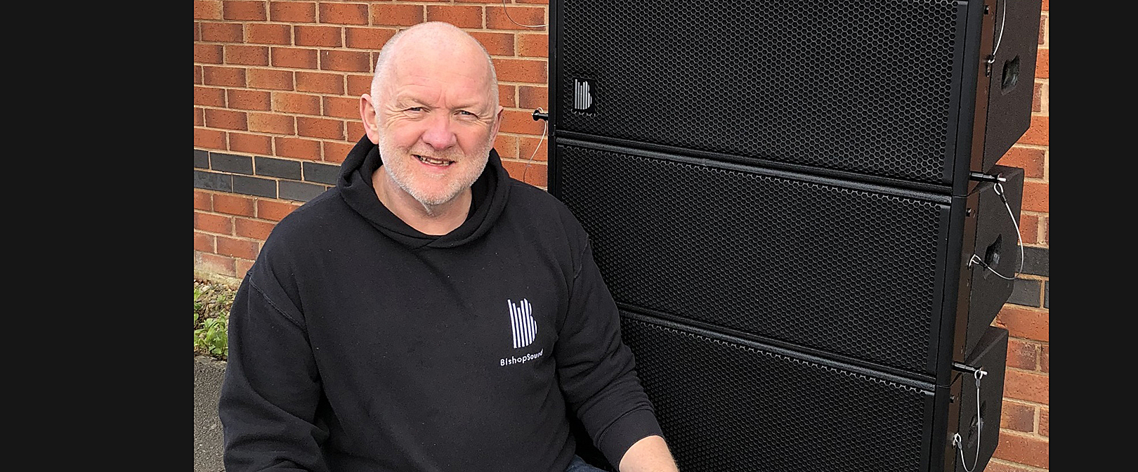 """Owner Andrew Bishop with the new Delta dual-8"""" passive line array"""