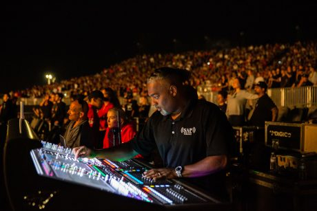 FOH Engineer Darcy Khan running Logic's mix on one of the tour's two SD7 consoles (photo credit: Debi Del Grande)