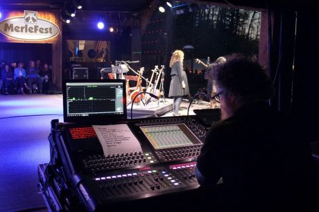 Bela Fleck and Abigail Washburn on MerleFest's Watson Stage, with monitors being mixed on a DiGiCo SD10 console