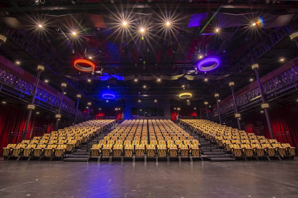 Situated at the confluence of the Chippewa and Eau Claire Rivers in Eau Claire, Wisconsin, the 143,000 square-foot space includes a 1,200-seat proscenium theater, the 400-seat JAMF black-box theater, five flexible rehearsal rooms & galleries, and a light, sound, and video production lab, among many other rooms.