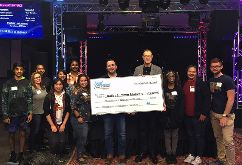 Sound Pro CEO Joshua Curlett (left) gave a big check to Ken Novice, president of Dallas Summer Musicals (right).
