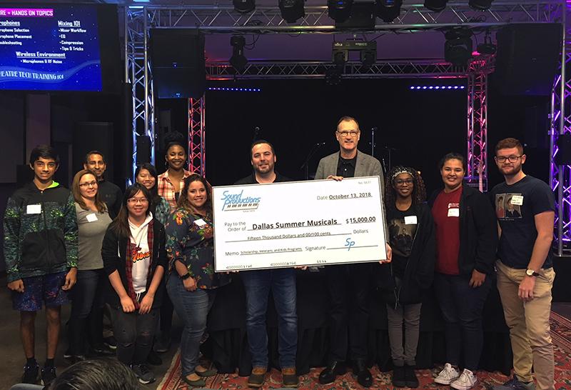 Sound Pro CEO Joshua Curlett (left) gave a big check to Ken Novice, president of Dallas Summer Musicals (right).