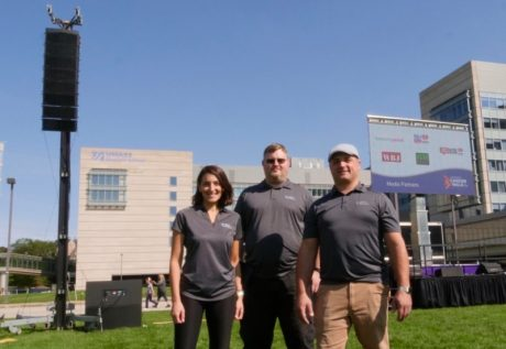 Revelation Productions' Director of Operations Amy Palumbo, Audio Engineer Josh Hamilton, and President Anthony D'Elia with their new EAW RADIUS line array system deployed for UMASS Medical.