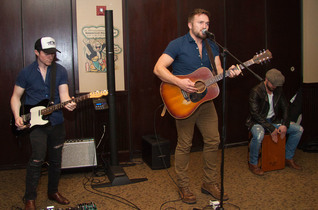 """With sound reinforcement by a Bose L1 Model 1S system and a T8S ToneMatch mixer, singer-songwriter Logan Mize performs his current single """"Better Off Gone"""" for a select gathering during an event commemorating over 100 million streams of Mize's album Come Back Road at The Palm in Nashville."""